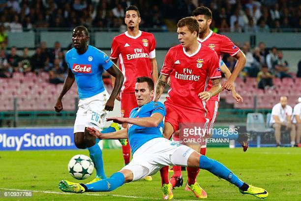 Napoli's forward from Poland Arkadiusz Milik vies with Benfica's Swedish defender Victor NilssonLindelof during the UEFA Champions League football...