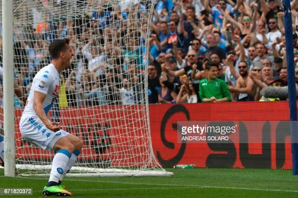 Napoli's forward from Poland Arkadliusz Milik celebrates after scoring during the Italian Serie A football match Sassuolo versus Napoli on April 23...