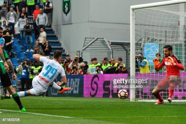 Napoli's forward from Poland Arkadliusz Milik scores during the Italian Serie A football match Sassuolo versus Napoli on April 23 2017 at Reggio...