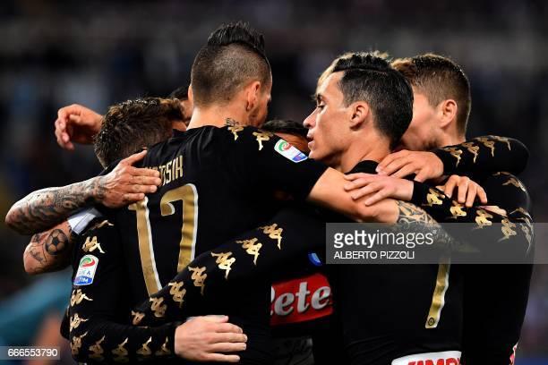 Napoli's forward from Spain Jose Maria Callejon celebrates with teammates after scoring during the Italian Serie A football match Lazio vs Napoli on...