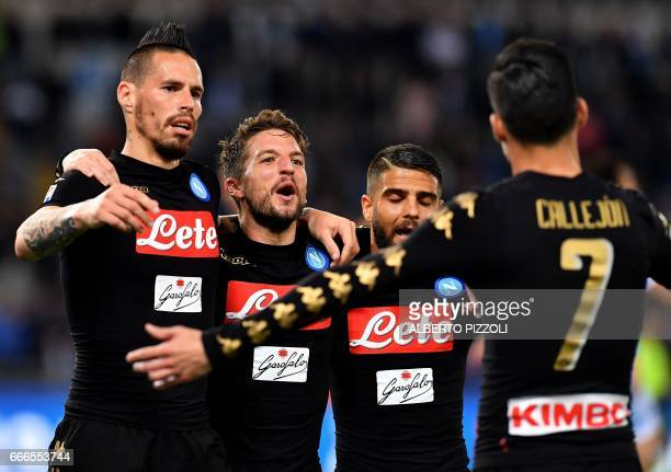 Napoli's forward from Spain Jose Maria Callejon celebrates with teammates Napoli's midfielder from Slovakia Marek Hamsik Napoli's forward from...
