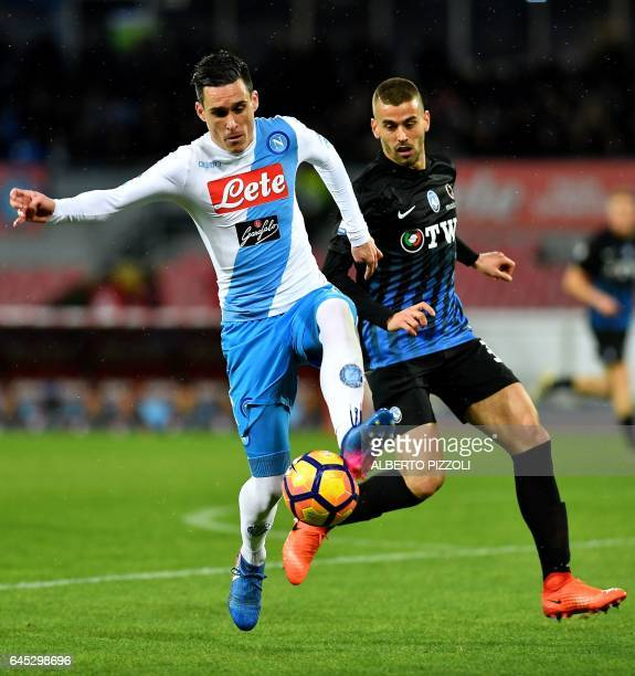 Napoli's forward from Spain Jose Maria Callejon fights for the ball with Atalanta's midfielder Leonardo Spinazzola during the Italian Serie A...