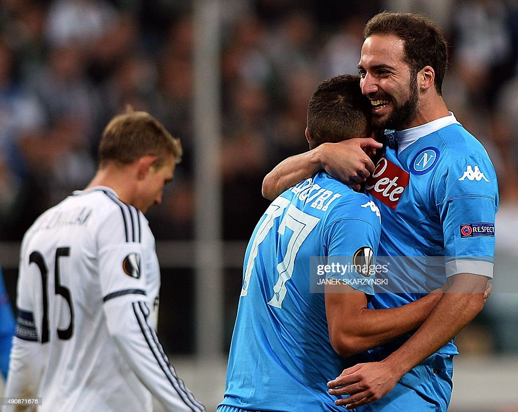 Napoli's forward Gonzalo Higuain and Omar El Kaddouri celebrate after Higuain scoredduring the UEFA Europa League firstleg Group D football match...