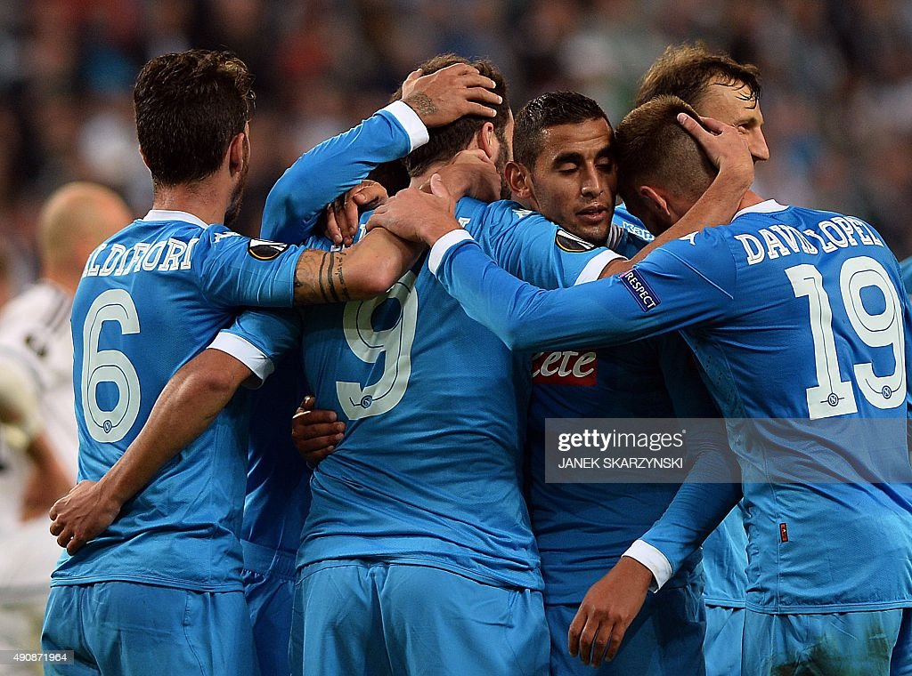 Napoli's forward Gonzalo Higuain celebrates scoring with his teammates during the UEFA Europa League firstleg Group D football match Legia Warszawa v...