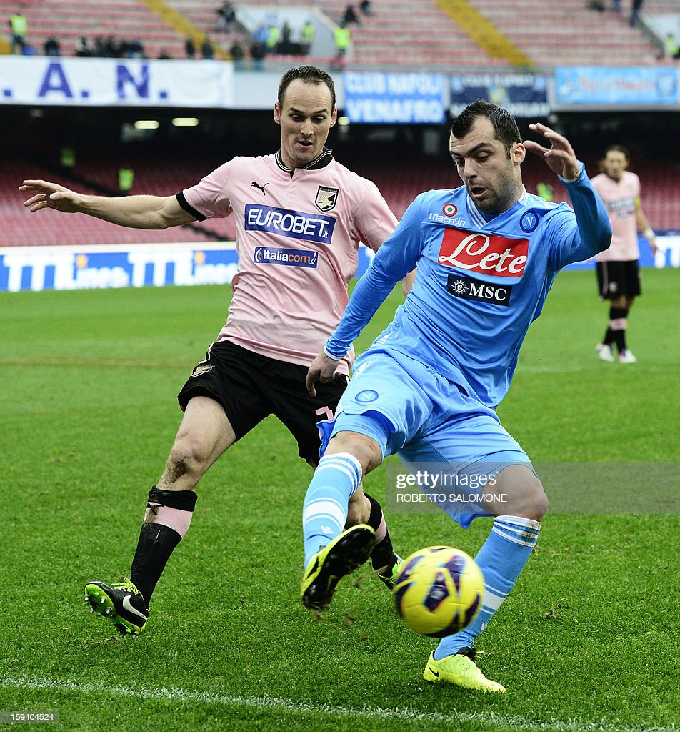 SSC Napoli's forward Goran Pandev (R) vies with Palermo's Vob Bergen during an Italian Serie A football match SSC Napoli vs US Palermo at San Paolo Stadium in Naples on January 13, 2013. AFP PHOTO / ROBERTO SALOMONE