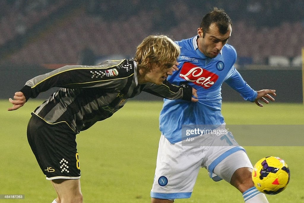 SSC Napoli's forward Goran Pandev (R) vies with Udinese's Milos Basta during the Italian Serie A football match SSC Napoli vs Udinese at the San Paolo Stadium in Naples on December 7, 2013.