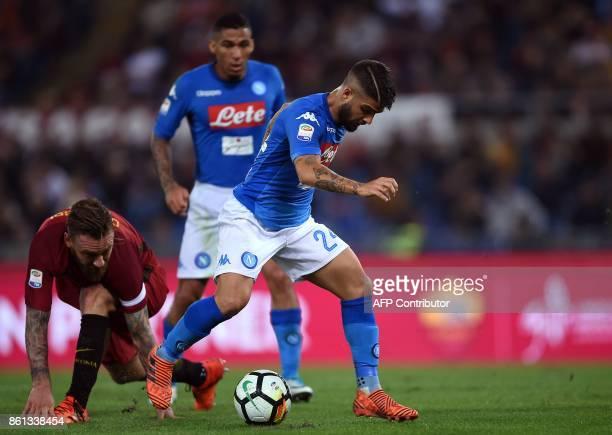 Napoli's forward Lorenzo Insigne vies with Roma's midfielder Daniele De Rossi during the Italian Serie A football match Roma vs Napoli at the Olympic...