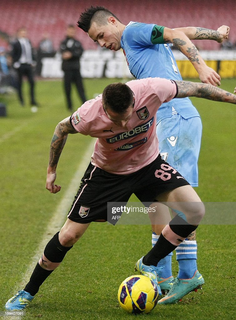 Napoli's forward Marek Hamsik (R) vies for the ball with Palermo's midfielder Michel Morganella during the Italian Serie A football match SSC Napoli vs US Palermo won by SSC Napoli 3-0 at San Paolo Stadium in Naples on January 13, 2013.