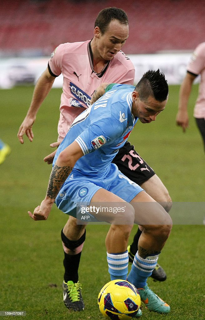 Napoli's forward Marek Hamsik (R) vies for the ball with Palermo's midfielder Steve Von Bergen during the Italian Serie A football match SSC Napoli vs US Palermo won by SSC Napoli 3-0 at San Paolo Stadium in Naples on January 13, 2013.