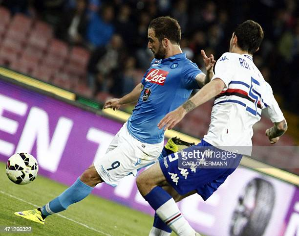 Napoli's French and Argentinian forward Gonzalo Higuain vies for the ball with Sampdoria's Italian defender Alessio Romagnoli during the Italian...