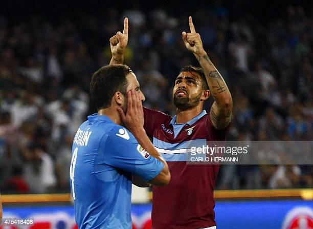 Napoli's French Argentinan forward Gonzalo Higuain reacts after missing a penalty as Lazio's Brazilian defender Mauricio gestures during the Italian...