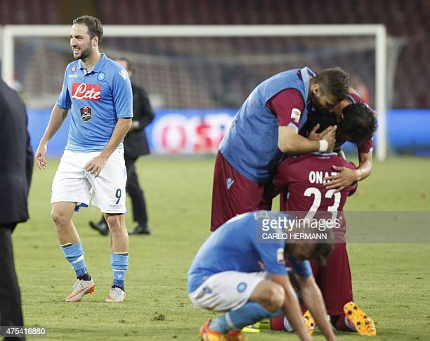 Napoli's French Argentinan forward Gonzalo Higuain reacts as Lazio's players celebrate at the end of the the Italian Serie A football match SSC...