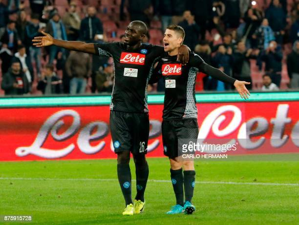 Napoli's French defender Kalidou Koulibaly and Napoli's Italian midfielder Jorginho celebrate at the end during the Italian Serie A football match...