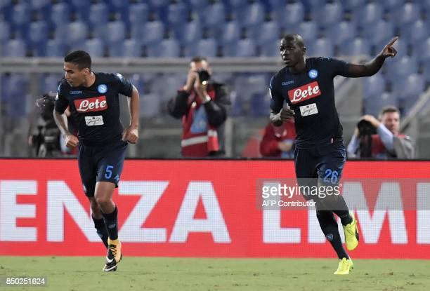 Napoli's French defender Kalidou Koulibaly celebrates after scoring during the Serie A football match between Lazio and Napoli at Olympic Stadium in...