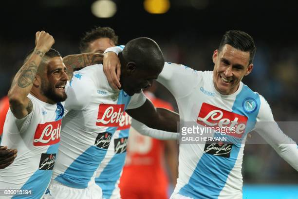 Napoli's French defender Kalidou Koulibaly celebrates with teammates Napoli's midfielder from Spain Jose Maria Callejon and Napoli's midfielder from...