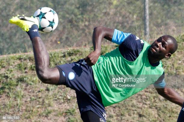 Napoli's French defender Kalidou Koulibaly controls the ball during a training session on the eve of the UEFA Champions League Group F football match...