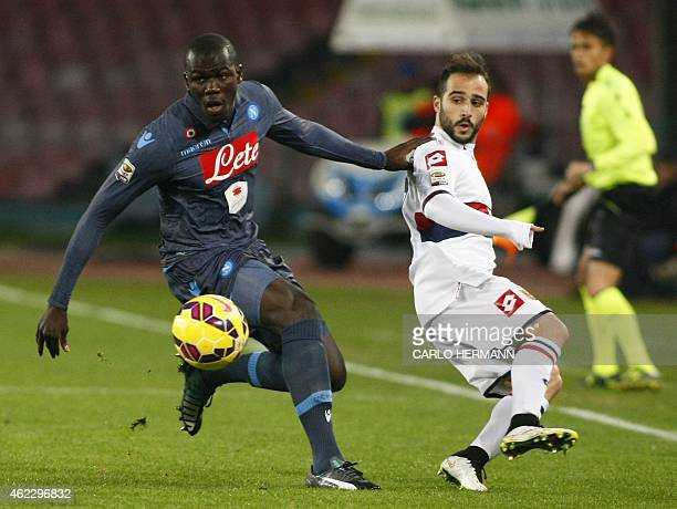 Napoli's French defender Kalidou Koulibaly fights for the ball with Genoa's Greek midfielder Ioannis Fetfatzidis during the Italian Serie A football...