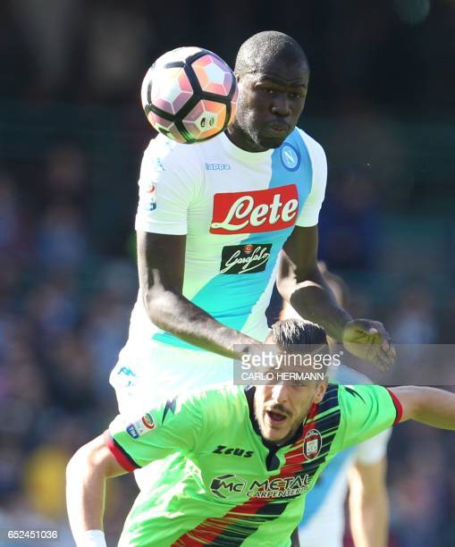 Napoli's French defender Kalidou Koulibaly heads the ball as fighting with Crotone's Italian forward Diego Falcinelli during the Italian Serie A...
