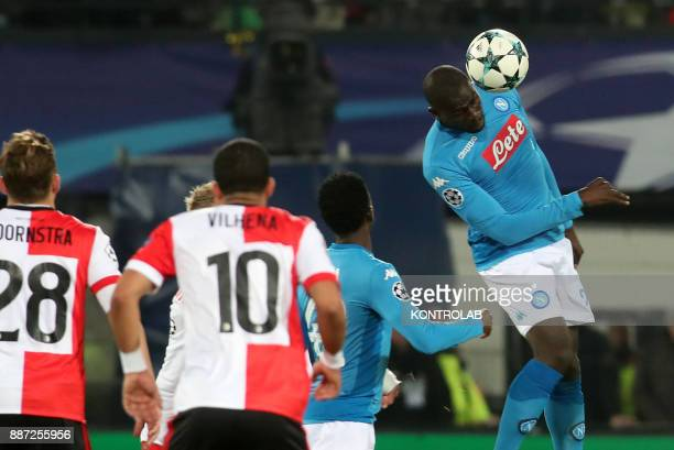 STADIUM ROTTERDAM NETHERLANDS Napoli's French defender Kalidou Koulibaly heads the ball during the UEFA Champions League Group F football match...