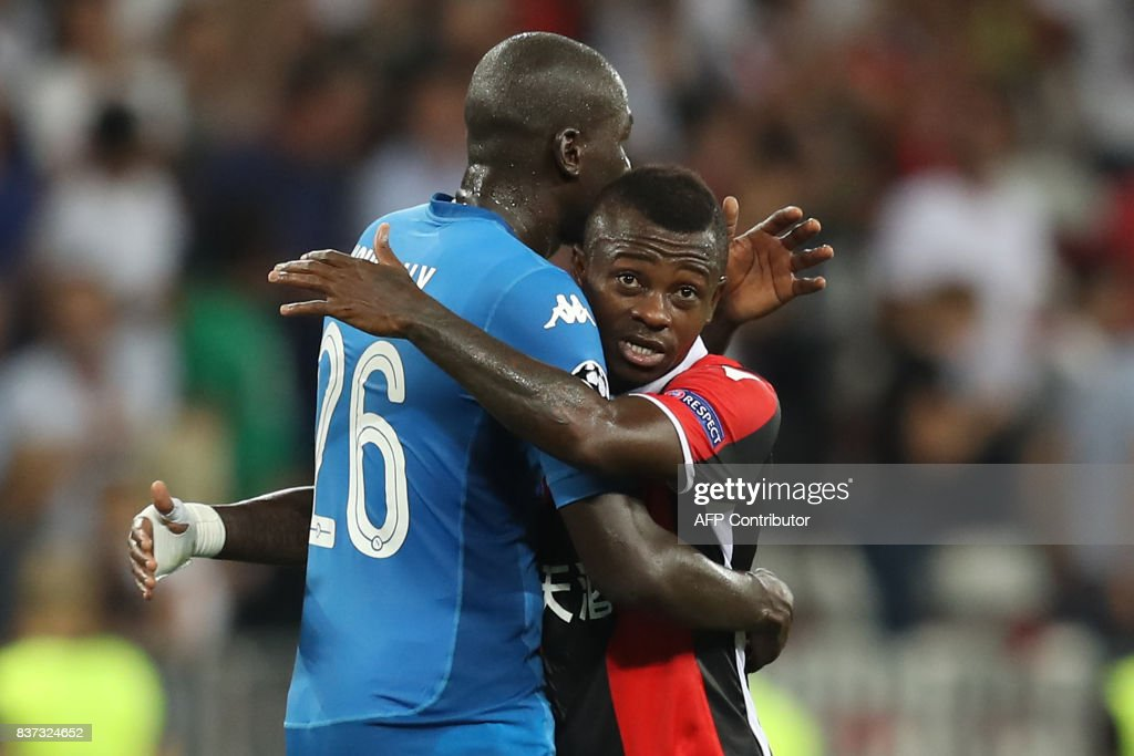 Napoli's French defender Kalidou Koulibaly (L) hugs Nice's Ivorian midfielder Jean Michael Seri (R) at the end of the UEFA Champions League play-off football match between Nice and Napoli. on August 22, 2017, at the Allianz Riviera stadium in Nice, southeastern France. /