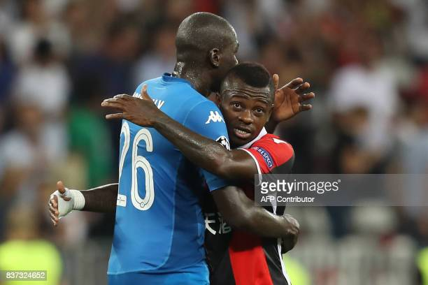 Napoli's French defender Kalidou Koulibaly hugs Nice's Ivorian midfielder Jean Michael Seri at the end of the UEFA Champions League playoff football...