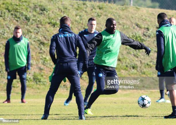 Napoli's French defender Kalidou Koulibaly takes part in a training session on the eve of the UEFA Champions League Group F football match Feyenoord...