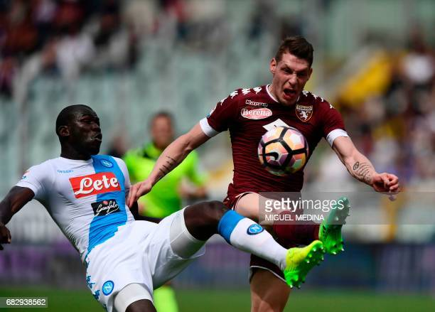 Napoli's French defender Kalidou Koulibaly vies with Torino's Italian forward Andrea Belotti during the Italian Serie A football match Torino vs...