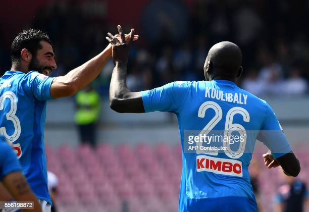 Napoli's French Senegalese defender Kalidou Koulibaly celebrates with Napoli's defender from Spain Raul Albiol after scoring during the Italian Serie...