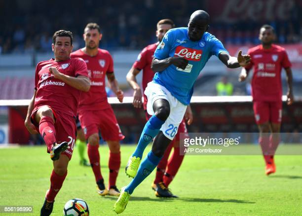 Napoli's French Senegalese defender Kalidou Koulibaly fights for the ball with Cagliari's defender Simone Padoin during the Italian Serie A football...