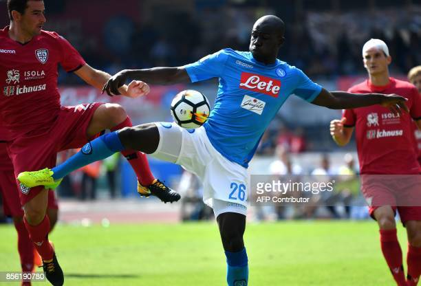 Napoli's French Senegalese defender Kalidou Koulibaly scores during the Italian Serie A football match Napoli vs Cagliari on October 1 2017 at San...