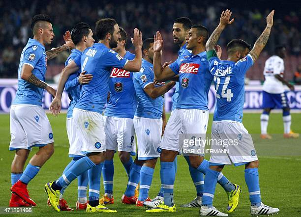 Napoli's FrenchArgentinian forward Gonzalo Higuain celebrates with teammates after scoring a goal during the Italian Serie A football match between...