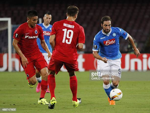 Napoli's FrenchArgentinian forward Gonzalo Higuain vies with Brugge's Belgian defender Thomas Meunier and Brugge's Costa Rican defender Oscar Duarte...