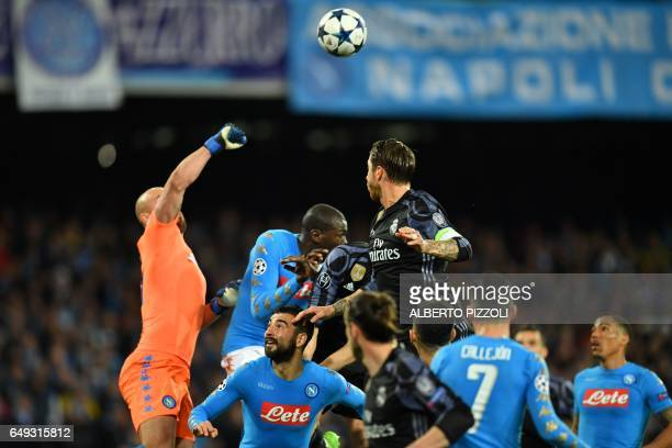 Napoli's goalkeeper from Spain Pepe Reina deflects the ball during the UEFA Champions League football match SSC Napoli vs Real Madrid on March 7 2017...