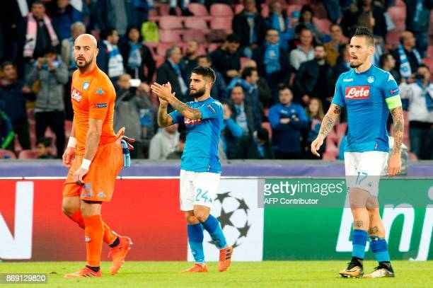 Napoli's goalkeeper from Spain Pepe Reina Napoli's midfielder from Italy Lorenzo Insigne and Napoli's midfielder from Spain Jose Maria Callejon greet...
