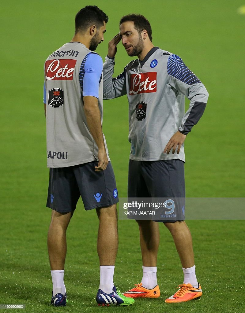 Napoli s Gonzalo Higuain R talks with Raul Albiol during a