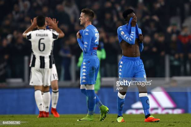 Napoli's Guinean midfielder Amadou Diawara and Napoli's Polish midfielder Piotr Zielinski react at the end of the Italian Tim Cup football match...