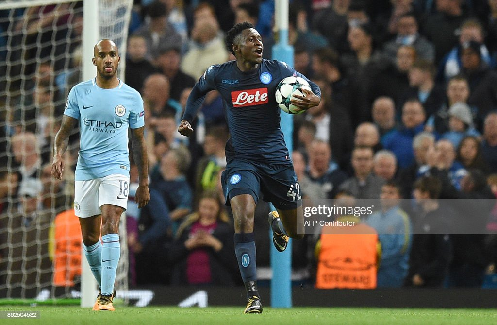 Napoli's Guinean midfielder Amadou Diawara celebrates scoring his team's first goal from the penalty spot during the UEFA Champions League Group F football match between Manchester City and Napoli at the Etihad Stadium in Manchester, north west England, on October 17, 2017. / AFP PHOTO / Oli SCARFF