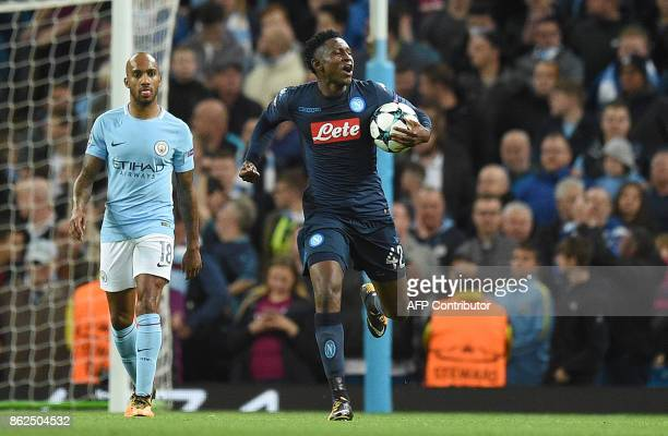 Napoli's Guinean midfielder Amadou Diawara celebrates scoring his team's first goal from the penalty spot during the UEFA Champions League Group F...