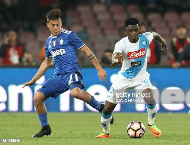 Napoli's Guinean midfielder Amadou Diawara fights for the ball with Juventus' forward from Argentina Paulo Dybala during the Tim Cup semifinal second...