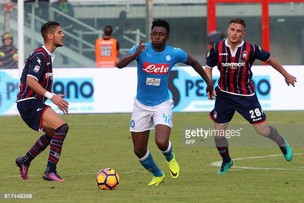 Napoli's Guinean midfielder Amadou Diawara vies with Crotone's midfielder Leonardo Capezzi during the Italian Serie A football match between FC...