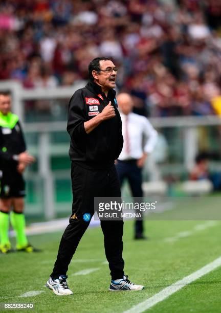 Napoli's Italian coach Mauricio Sarri gestures during the Italian Serie A football match Torino vs Napoli at the Olympic stadium in Turin on May 14...
