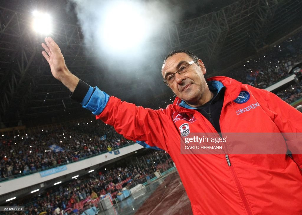 Napoli's Italian coach Maurizio Sarri greets fans at the end of the Italian Serie A football match SSC Napoli vs Frosinone Calcio on May 14 2016 at the San Paolo stadium in Naples. Napoli won the match 4-0. / AFP / CARLO