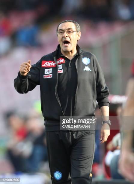 Napoli's Italian coach Maurizio Sarri reacts during the Italian Serie A football match SSC Napoli vs Cagliari Calcio on May 6 2017 at the San Paolo...