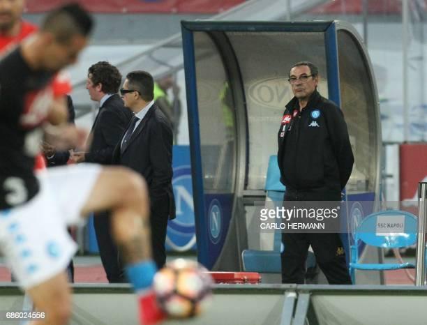 Napoli's Italian coach Maurizo Sarri looks on before the Italian Serie A football match SSC Napoli vs Fiorentina ACF on May 20 2017 at the San Paolo...
