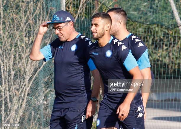 Napoli's Italian coach Maurizo Sarri talks with Napoli's Algerian defender Faouzi Ghoulam during a training session on the eve of the UEFA Champions...
