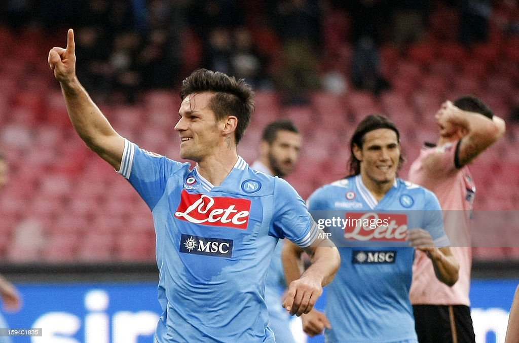 Napoli's Italian defender Christian Maggio (L) celebrates after scoring a goal during an Italian Serie A football match between SSC Napoli and USC Palermo in San Paolo Stadium on January 13, 2013.