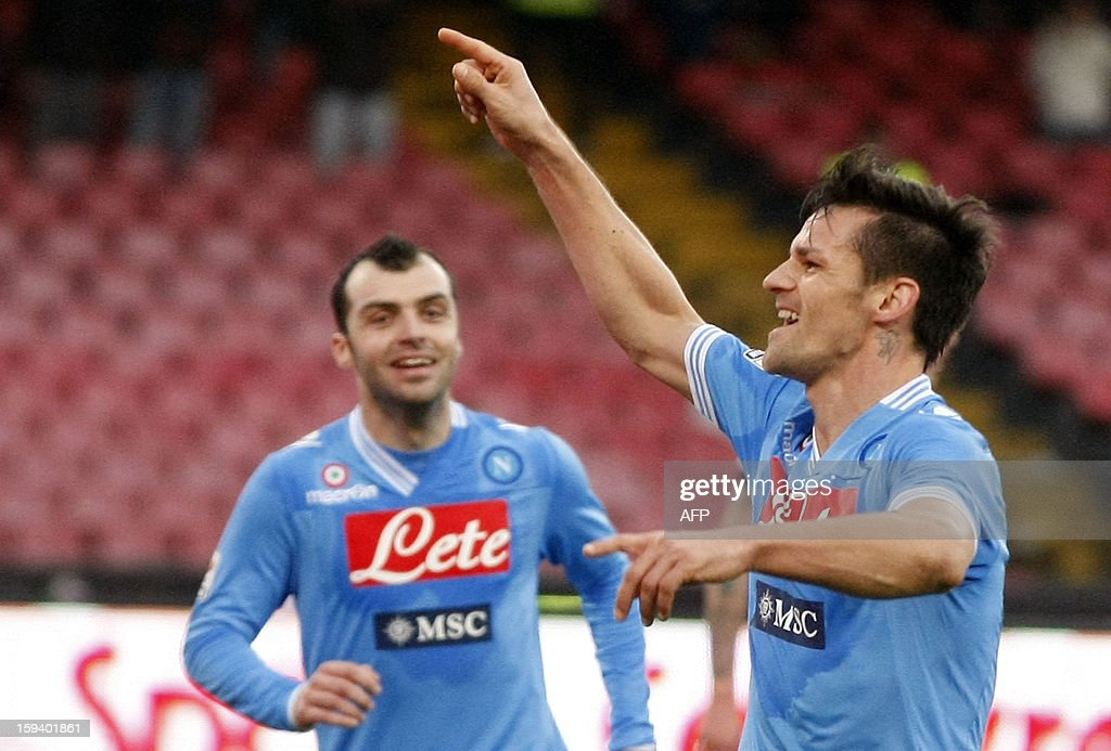 Napoli's Italian defender Christian Maggio celebrates after scoring a goal during an Italian Serie A football match between SSC Napoli and USC Palermo in San Paolo Stadium on January 13, 2013.
