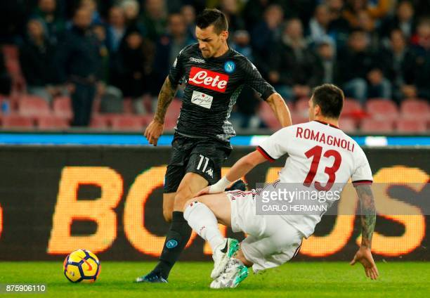 Napoli's Italian defender Christian Maggio fights for the ball with Milan's Italian defender Alessio Romagnoli during the Italian Serie A football...