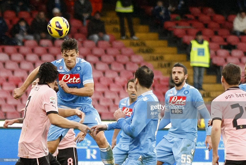 Napoli's Italian defender Christian Maggio (2nd L) heads the ball to score during an Italian Serie A football match between SSC Napoli and USC Palermo in San Paolo Stadium on January 13, 2013. AFP PHOTO / CARLO HERMANN