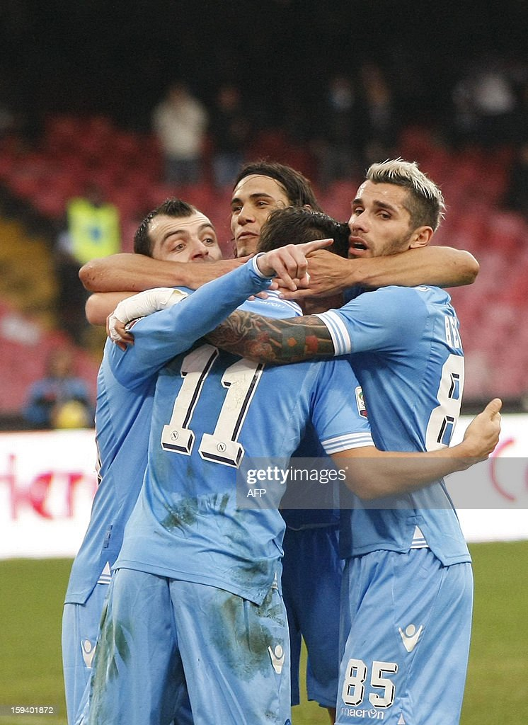 Napoli's Italian defender Christian Maggion (11) is congratulated by team mates after scoring a goal during an Italian Serie A football match between SSC Napoli and USC Palermo in San Paolo Stadium on January 13, 2013.